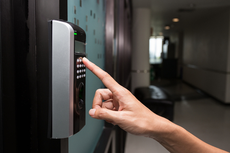 Employee Entering a Code on an Access Control System